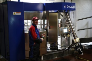 Mar 21/12 - Brian Christening the VMS robotic milking station!
